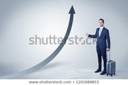 Businessman hitchhiking with progressive arrow Stock photo © ra2studio