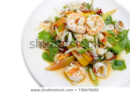 delicious seafood salad with vegetables and shrimps on the table stock photo © dashapetrenko