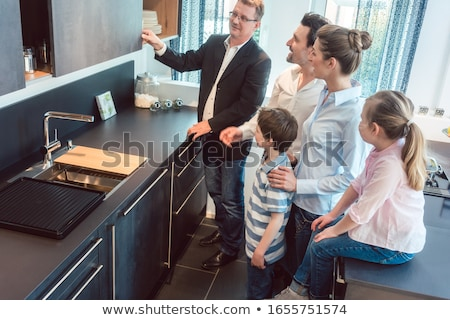 Kitchen sales with a family, kids, and a service expert Foto d'archivio © Kzenon