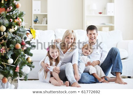 Christmas Family at Home, People by Pine Tree Foto stock © robuart