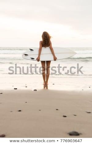 Surfen meisje lang haar surfen jonge surfer Stockfoto © ElenaBatkova
