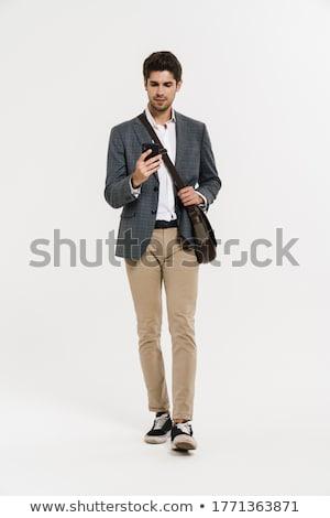 Foto knap suits smartphone lopen Stockfoto © deandrobot