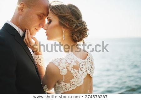 Esküvő szerelmespár hegyek tenger víz lány Stock fotó © ElenaBatkova