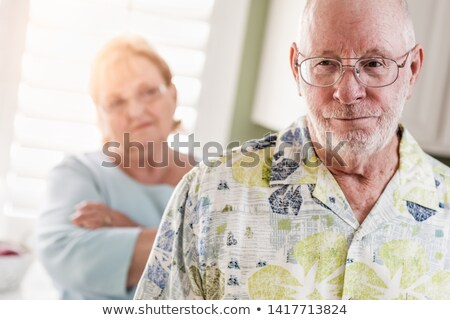 Senior Adult Couple in Dispute or Consoling in Kitchen of House Stock photo © feverpitch