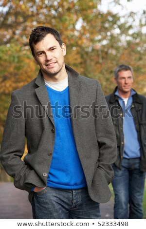 Two Men Standing Outside In Autumn Woodland Stock photo © monkey_business