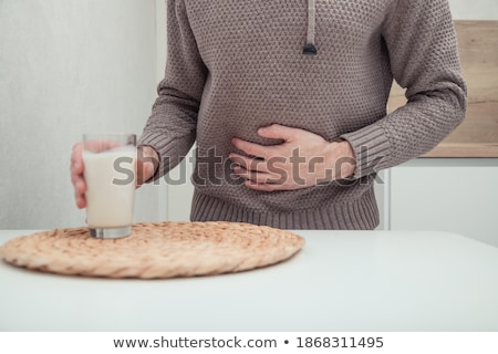 man rejecting glass of milk stock photo © andreypopov