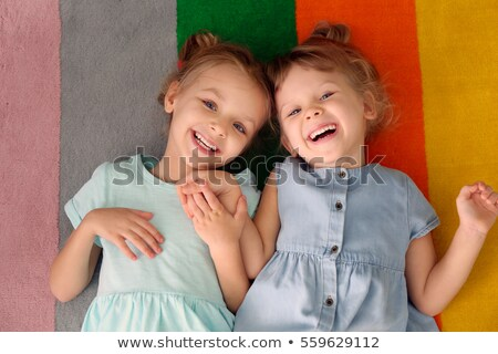 two cheerful little sisters laughing together stock photo © giulio_fornasar