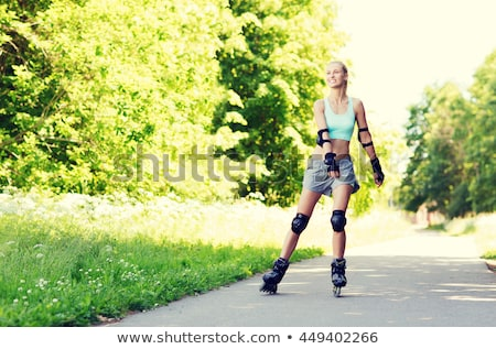 A woman with is rollerblade in summer time Stock photo © Lopolo