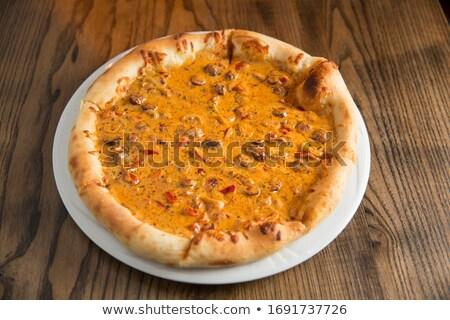ピザ チーズ ビーフステーキ キノコ ソース 木製のテーブル ストックフォト © boggy