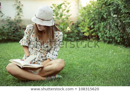 beautiful caucasian woman reading a book at the park stock photo © nobilior