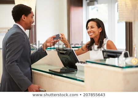 Greeting from happy black woman on business travel Stock photo © darrinhenry