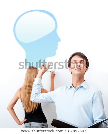 Biology or psycology lesson. Teacher giving lecture with help of Stock photo © HASLOO