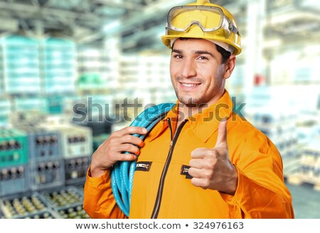 Stock photo: Thumbs up from an electrician