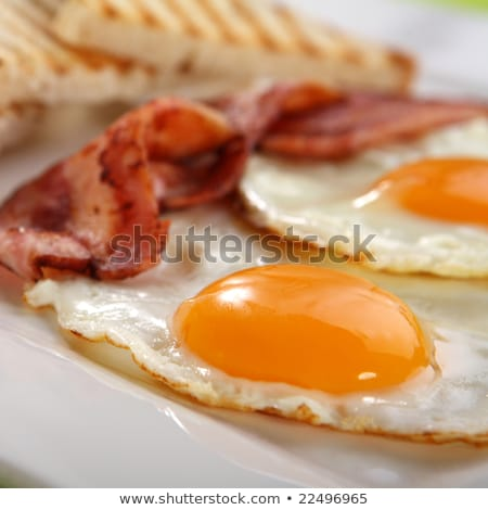 Bacon, eggs and toasts close up Stock photo © zhekos