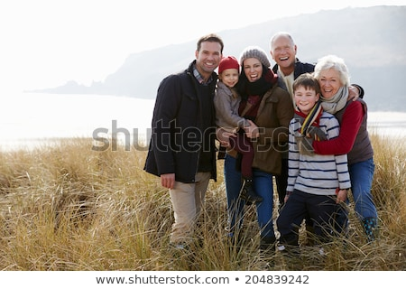 Family Portrait in a dune Stock fotó © photography33