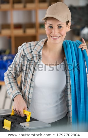 female electrician carrying coil stock photo © photography33