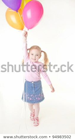 Studio shot of a little girl with a balloon Stock photo © photography33