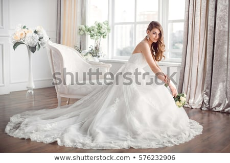 Fashion model lovely female in bridal dress - wedding style stock photo © gromovataya