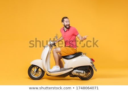 casual man sitting pointing to a side stock photo © feedough