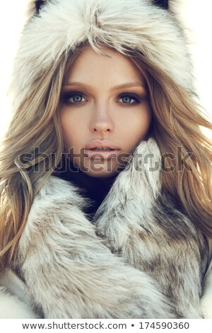 Attractive woman in furry winter hat Stock photo © stryjek