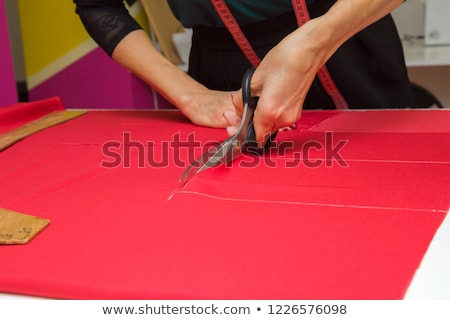 scissors on red fabric stock photo © marcogovel