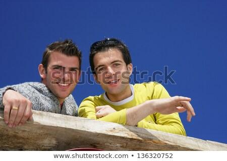 Iki erkek arkadaşlar balkon saç düşünme Stok fotoğraf © photography33