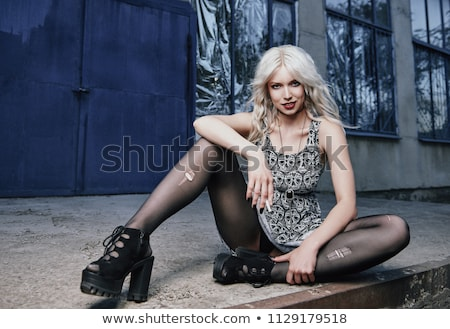 Smiling pretty young blonde in torn pantyhose Stock photo © acidgrey
