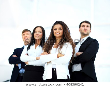 young smiling businesswoman looking confident while being followed by her colleagues stock photo © wavebreak_media