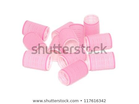 Twelve pink velcro rollers in a jumbled pile Stock photo © sarahdoow