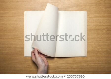 hand turning old blank book page stock photo © sqback