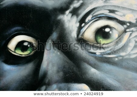 portrait of angry man graffiti over concrete stock photo © lunamarina