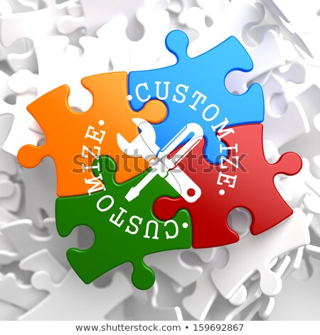 customize concept on multicolor puzzle stock photo © tashatuvango