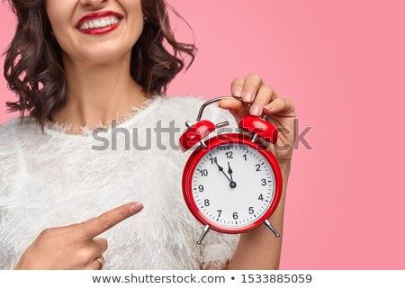 lady pointing at alarm clock stock photo © get4net