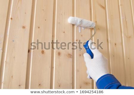 Paint roller on wooden background Stock photo © stevanovicigor