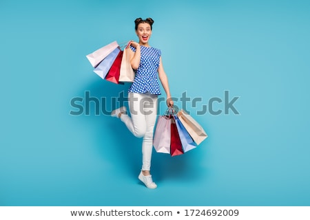 Young girls with shopping bags in store Stock photo © HASLOO