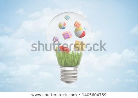 light bulb sign in blue glass blocks Stock photo © marinini