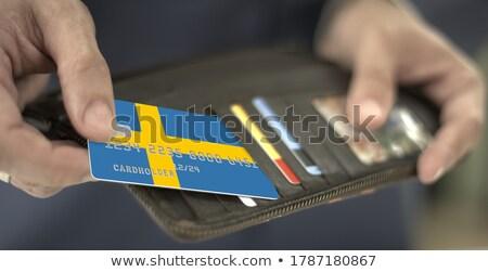 Swedish Businessman holding business card with Sweden Flag Stock photo © stevanovicigor