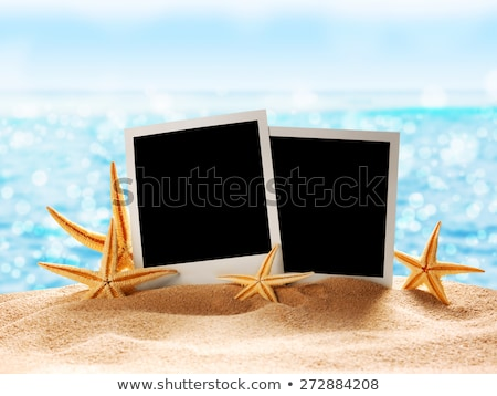 Photo card on sand background, old style Stock photo © smeagorl