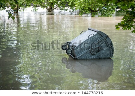 Floating dumpster in flood Stock photo © Kayco