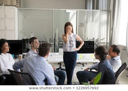 Foto stock: Empresária · sorridente · tímido · belo · olhando · para · baixo · mulher