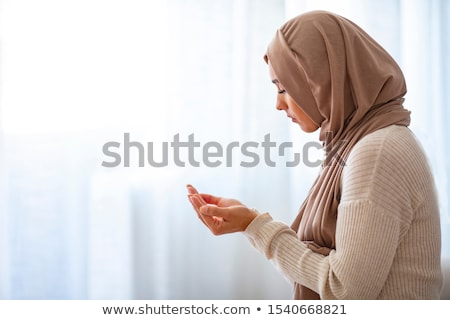 indian young woman praying stock photo © bmonteny