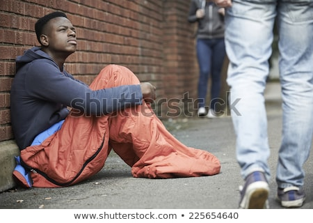 Homeless Teenage Boy In Sleeping Bag On The Street Stock photo © HighwayStarz