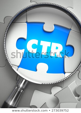 ctr   puzzle with missing piece through loupe stock photo © tashatuvango