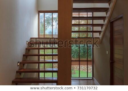 spiral wooden staircase in a green garden stock photo © artfotoss