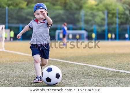 Ninos jugando fútbol pena patear Blur deporte Foto stock © stevanovicigor