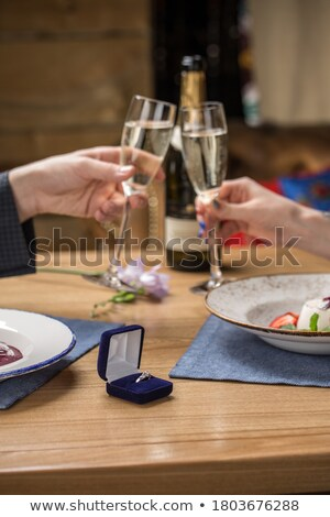 side view of an elegant couple with champagne and glasses stock photo © feedough