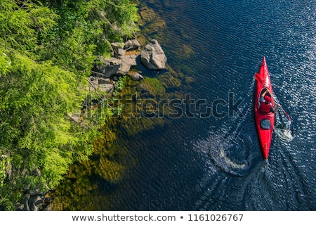 aerial view of canoe on river shore Stock photo © PixelsAway
