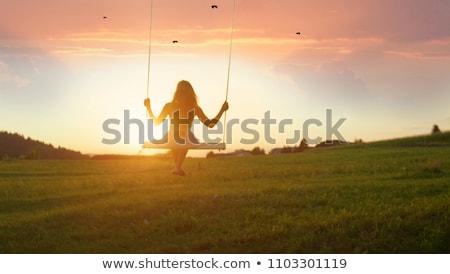 Meisje swing zonsondergang illustratie boom zon Stockfoto © adrenalina