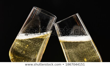 two festive champagne glasses stock photo © elisanth