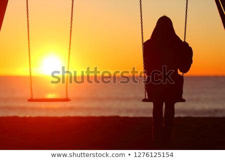Salıncak hippi kız beyaz elbise oturma bahçe Stok fotoğraf © runzelkorn